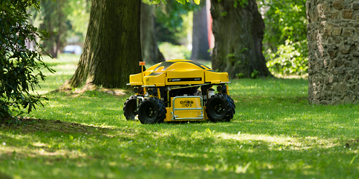 Spider ILD01 cutting grass in park with trees