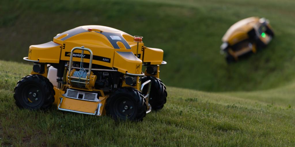 Spider ILD01 on grass with ILD02 in distance